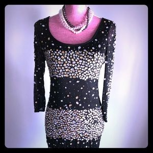 Quarter length sleeve bejeweled party dress